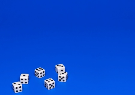 The dices on blue background. photo