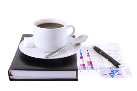 briefing: Coffee cup, standing on the personal organizer, on a back background-financial diagrams . Isolated Stock Photo