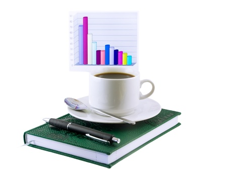Coffee cup, standing on the personal organizer, on a back background-financial diagrams . Isolated photo
