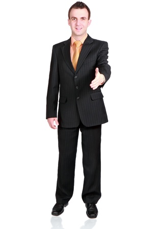 Cheerful businessman ready for handshake. Isolated over white. photo