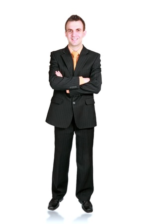 Caucasian businessman with crossed arms. Isolated over white photo