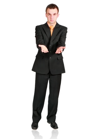Cheerful businessman show empty hands. Isolated over white photo