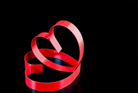 St. Valentine Day. Two hearts, on black background with reflection. photo