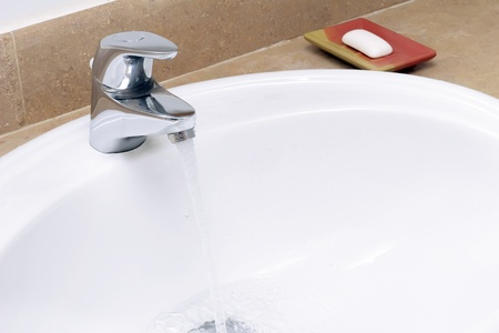 Faience sink and a piece of soap Stock Photo - 11827728