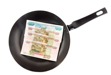 panful: Frying pan with the russians moneys- roubles. Fried money.Top view. Isolated