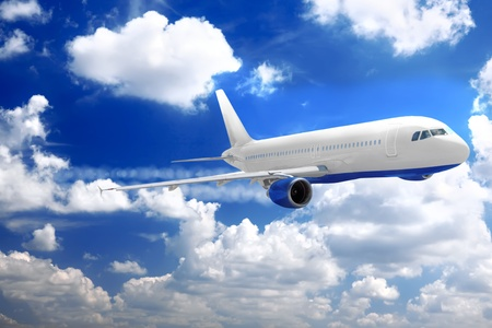 Modern airplane in a sky with clouds. Stock Photo
