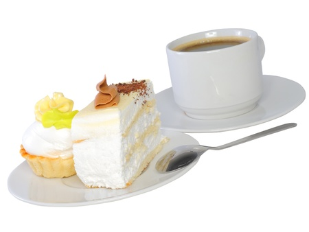 Sponge cakes with cup of coffee on plate with fruit-juice decoration . Isolated photo