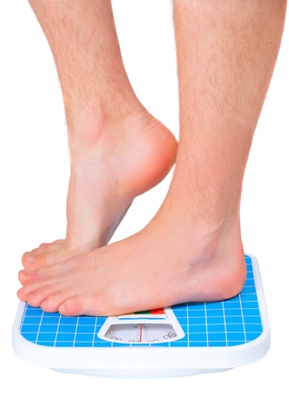 Man's legs , which weighed on floor scale. Isolated over white Stock Photo - 11826362