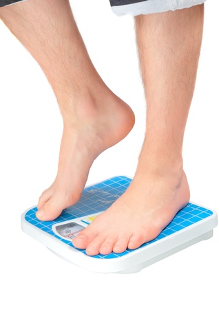 Mans legs , which weighed on floor scale. Isolated over white
