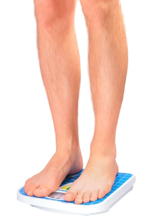 Man's legs , which weighed on floor scale. Isolated over white Stock Photo - 11827615