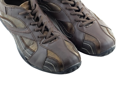 Pair of leather brown sneakers. Isolated photo