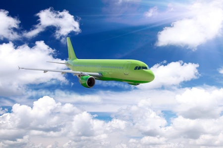avia: Modern airplane in a sky with clouds. Stock Photo