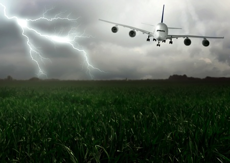 Lightning across and descend aircraft. Summer photo