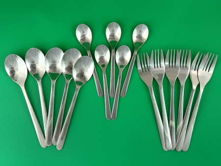 Collage of flatware on green background. photo