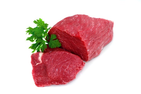 Cut of  beef steak with green leaf. Isolated. Stock Photo - 11834456