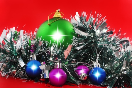 Christmas and and New Year decoration- balls, tinsel .On the red background. photo