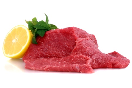 Cut of  beef steak  with lemon slice. Isolated.