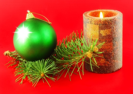 Christmas and New Year decoration-balls and candels on red background . photo