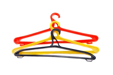 Red clothes hanger isolated over white. photo