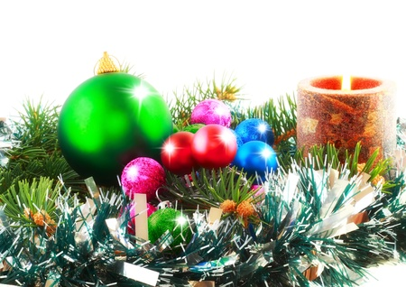 Christmas and New Year decoration- balls, tinsel, candels. Isolated on the white background photo