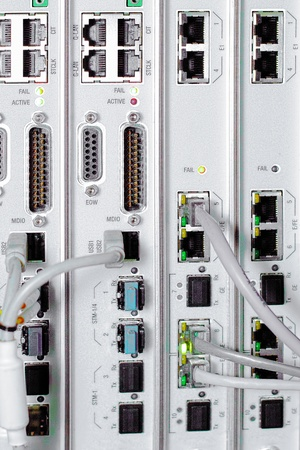 Telecommunication equipment of network cables in a datacenter of mobile operator. photo