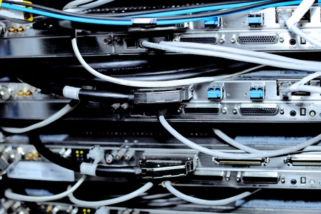 Telecommunication equipment of network cables in a datacenter of mobile operator. Stock Photo - 11896117
