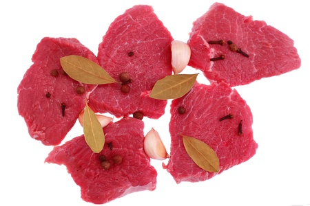 flavouring: Cut of  beef steak  with  laurel, garlic and  flavouring. Isolated. Stock Photo