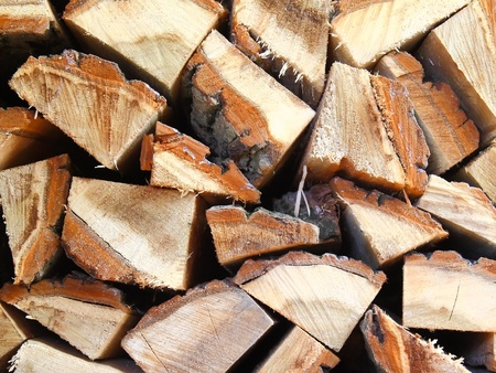 Firewood combined in a woodpile stack. photo