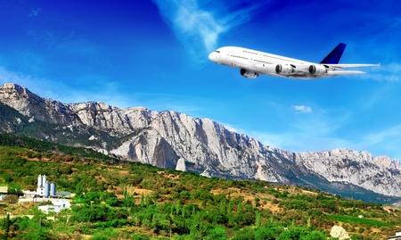 rocky mountain juniper: Modern airplane  in South part of Crimea. Ukraine.