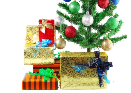 Fragment of Christmas and New Year Tree with gift boxes. Isolated over white background. photo
