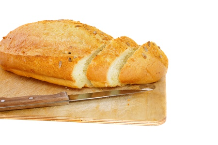 Fresh cutting bread. Isolated over white photo