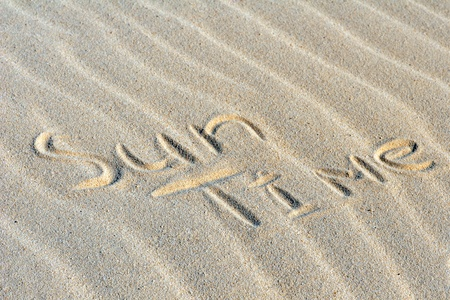 "Inscription ""Sun Time"" on a sand on beach"