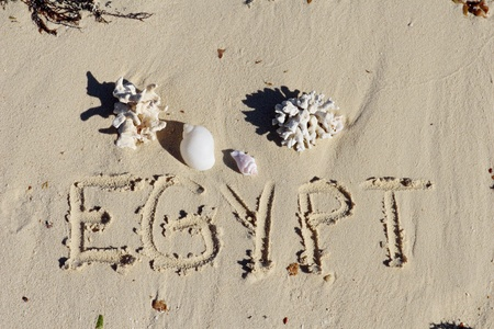 "Inscription "" Egypt"" on a sand n a beach."