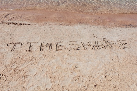 timeshare: Inscription TimeShare on a sand n a  beach. Stock Photo