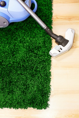 green carpet: Vacuum cleaner stand  on green carpet