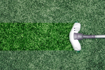 clean carpet: The metal pipe of vacuum cleaner in action - clean stripe on the carpet.
