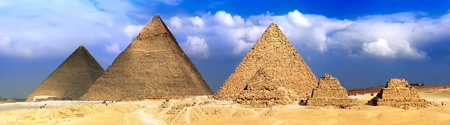Great Pyramids, located in Giza, the pyramid of Pharaoh Khufu, Khafre and Menkaure. Egypt. Panorama Stock Photo