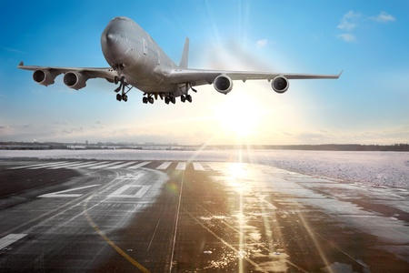 to depart: Passenger airplane landing on runway in airport. Evening  Stock Photo