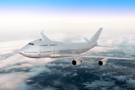 boeing: Modern airplane  over the clouds.
