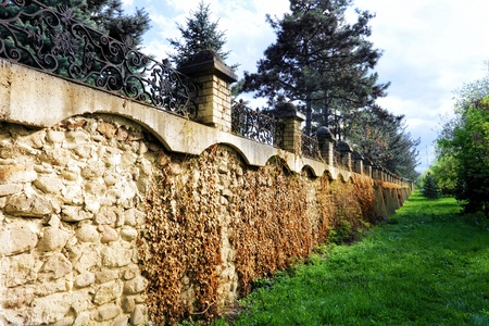 clinker tile: Fence placed a long brick wall.  Stock Photo