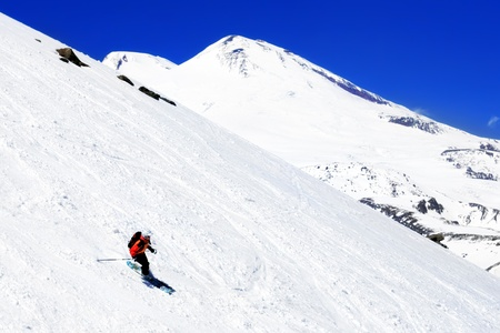 A skier descending Mount Elbrus - the highest peak in Europe. photo