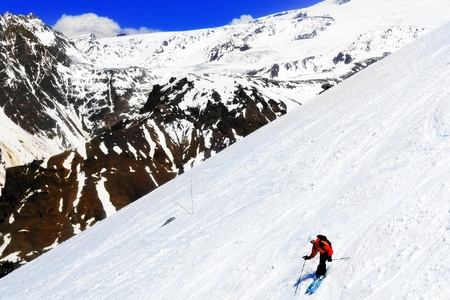 A skier descending Mount Elbrus - the highest peak in Europe  Stock Photo - 13553936