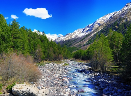 View of the mountains and river into the valley  Elbrus area  Europe Stock Photo - 13611285