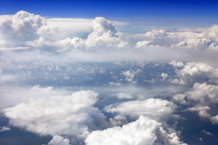 Beautiful view above the earth at the clouds below. Stock Photo - 14057416