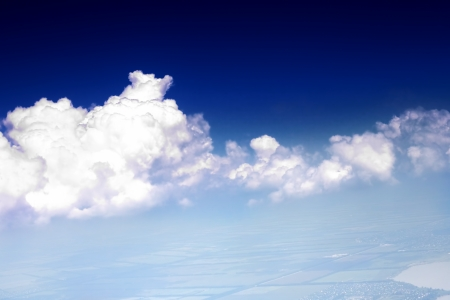 Beautiful view above the earth at the clouds below. Stock Photo - 14157349