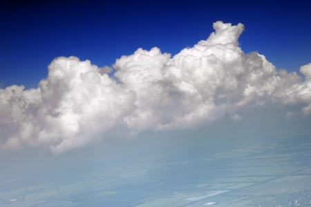 Beautiful view above the earth at the clouds below. Stock Photo - 14157875