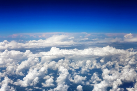Beautiful view above the earth at the clouds below. Stock Photo - 14157881