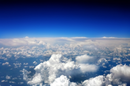 Beautiful view above the earth at the clouds below. Stock Photo - 14157878