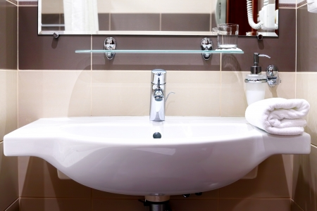 White  sink and towell in SPA salon. Stock Photo