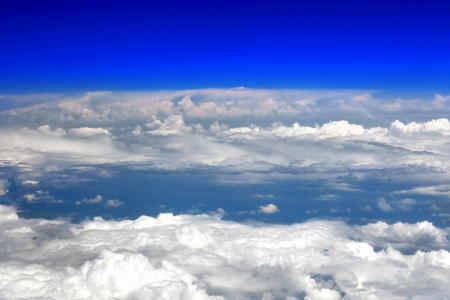 Beautiful view above the earth at the clouds below. Stock Photo - 14503565